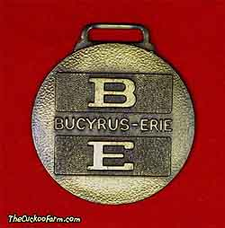 Bucyrus-Erie logo, Binder Machinery watch fob