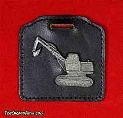 American Poclain Corporation excavator watch fob
