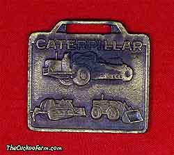 A Caterpillar trio - Ohio Machinery Co. watch fob