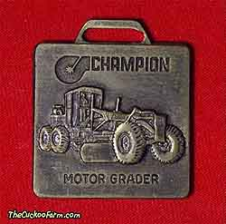 Champion motor grader watch fob